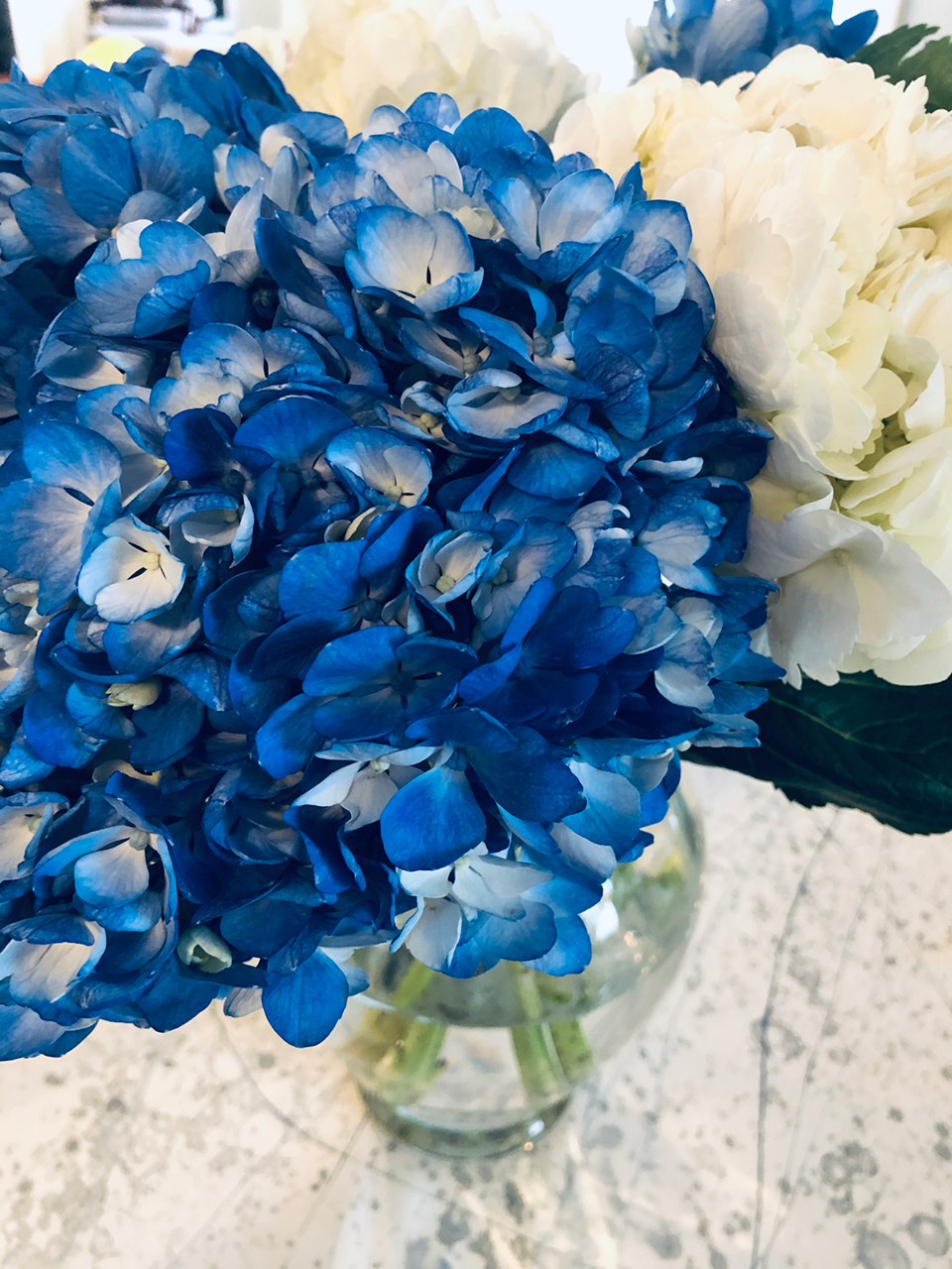 Blue and white wedding centerpiece created by Eden Rose Inspirations, a florist in Bowling Green Ohio